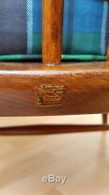 2 Antique dark wooden Ercol chairs Occasional Accent fireplace with cushions