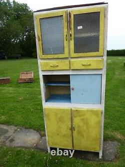 Vintage 1940s kitchen cupboard with three compartments. Two drawers